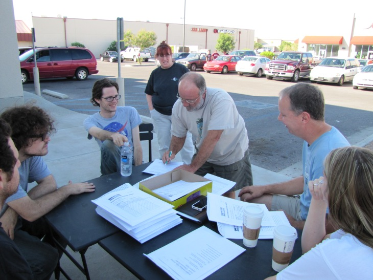 "Filmmaker Joe Widmar arrives with two minutes to spare Monday, Sept. 2, delivering his film ""Milton"" for the Camera Hogs team while WSIFF president Rob Sharp and fellow filmmakers cheer him on."