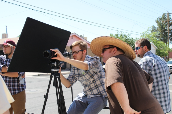 "Cinematographer Matt Wilson and director Aron Hethcox line up a shot during the filming of a teaser trailer for Wide Awake Productions' ""Magic Love Dust."""