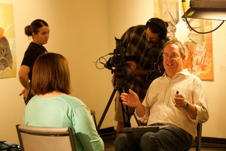 "Documentarian Phil Lewis conducts interviews at the NMSU Art Gallery for his ""place-based"" cinematic project ""Retablo: Painting My Miracle."""